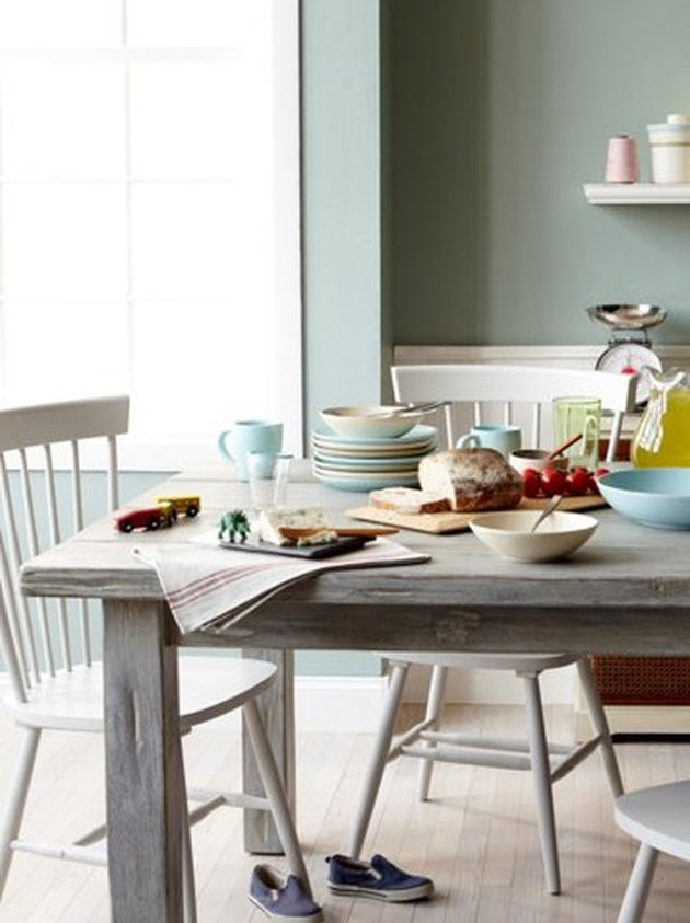 One Kings Lane farmhouse furniture with rustic dining table and chairs
