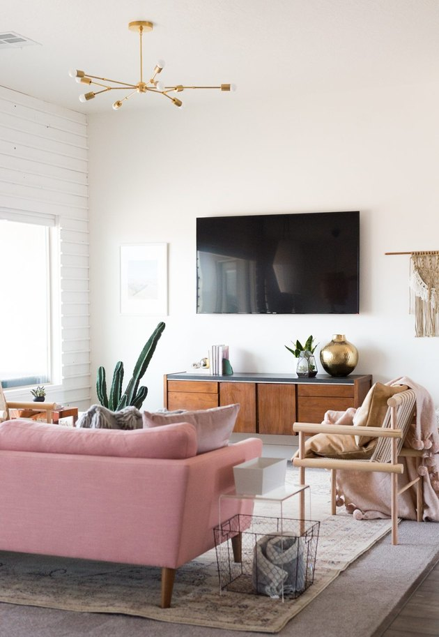 pink boho living room lighting idea with semi-flush pendant