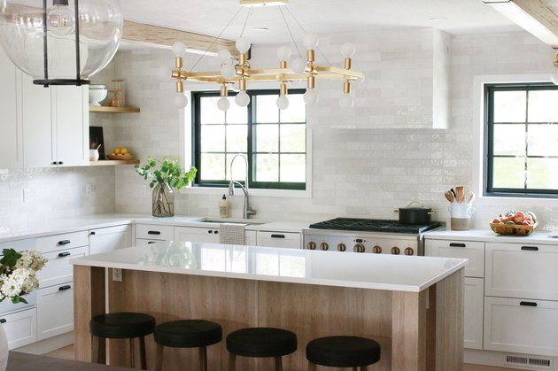kitchen with modern chandelier and white subway tile