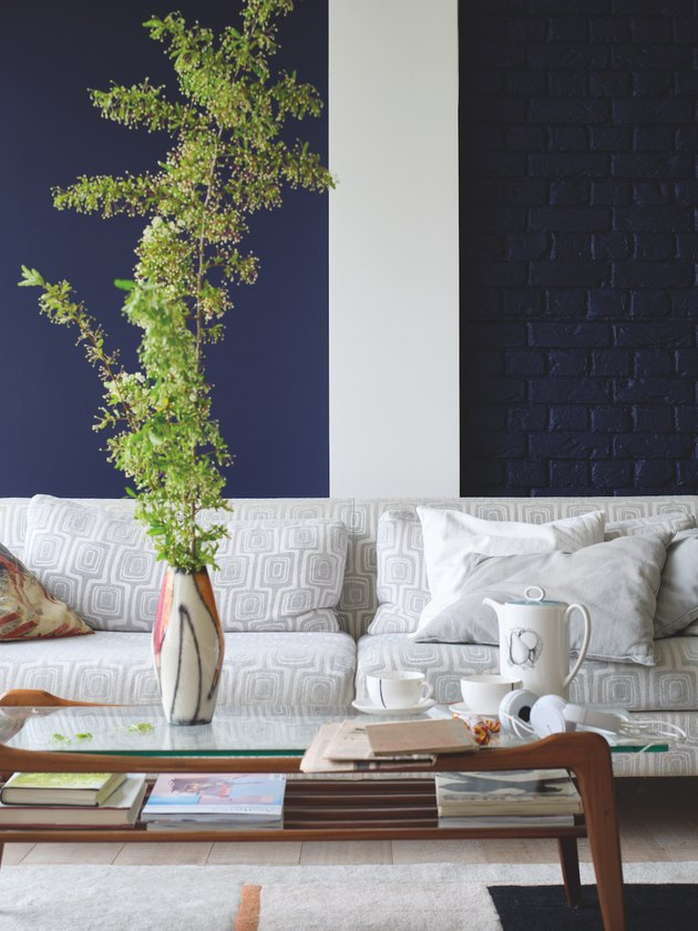 living room space with coffee table and blue walls