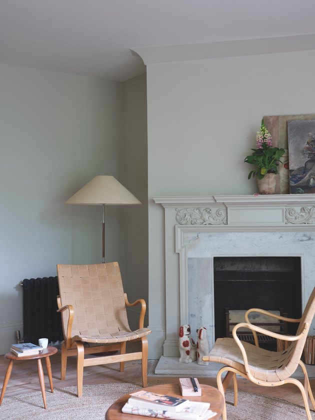 living room space with grey wall and fireplace