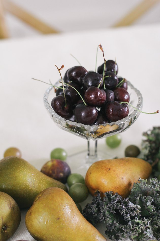 Bowl of long stem cherries