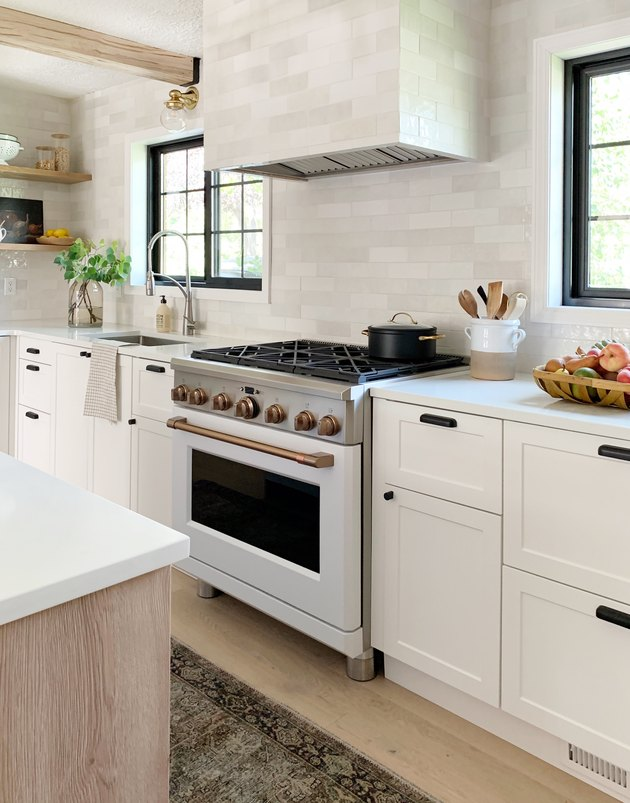 kitchen with white and brush bronze Cafe stove