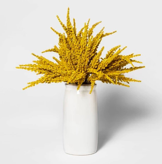 ceramic pot with artificial goldenrod arrangement