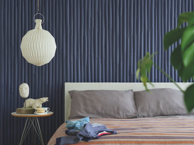 bedroom with blue wall and white light fixture