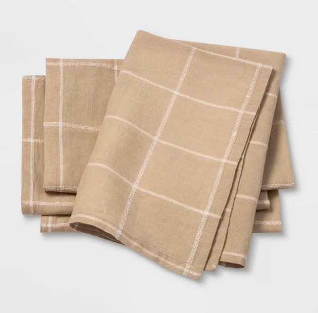 beige napkins with white windowpane pattern