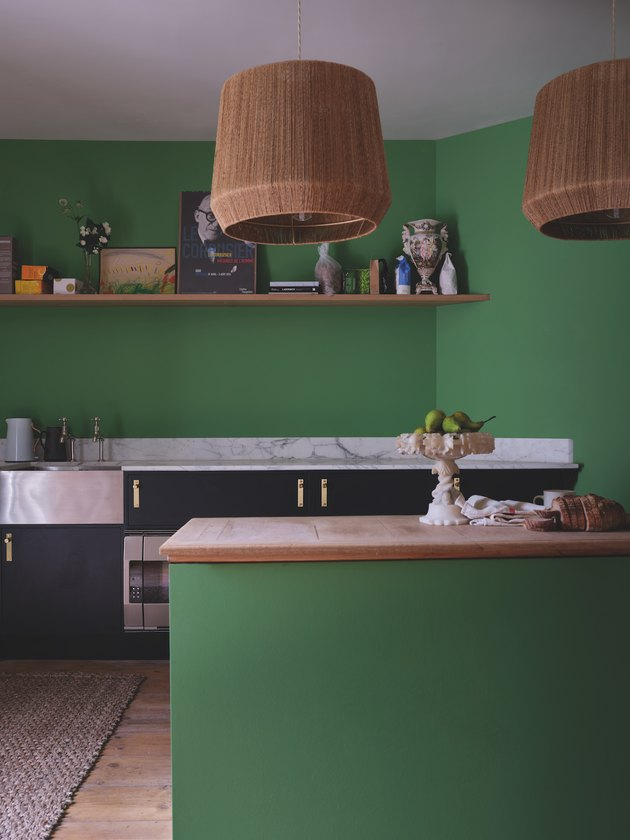 kitchen space with green wall