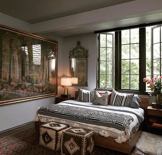 eclectic bedroom full of patterns and large scale artwork
