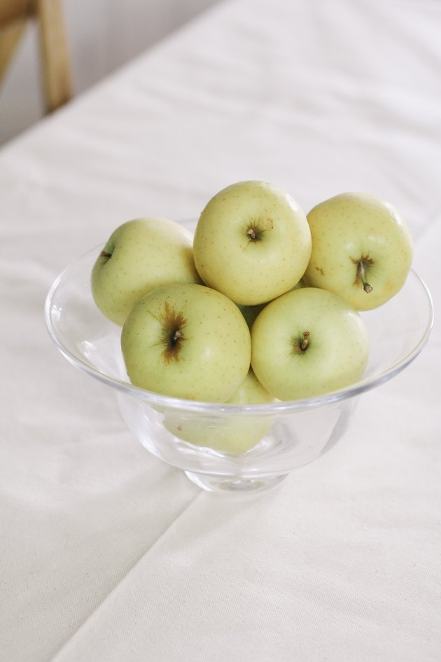 Bowl of yellow apples