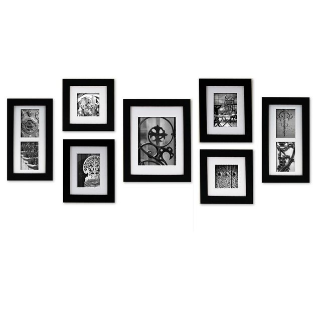Seven thick black picture frames in varying sizes