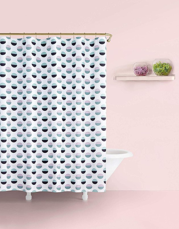 blush and navy dot shower curtain in pink room