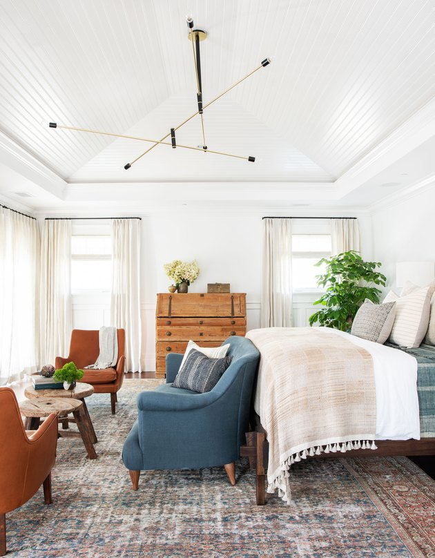 mobile bedroom chandelier hanging in the middle of the room above bed and loveseat