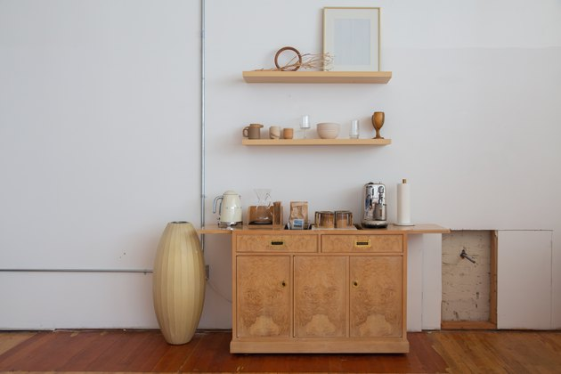 shelves and cabinet with cups and kitchenware