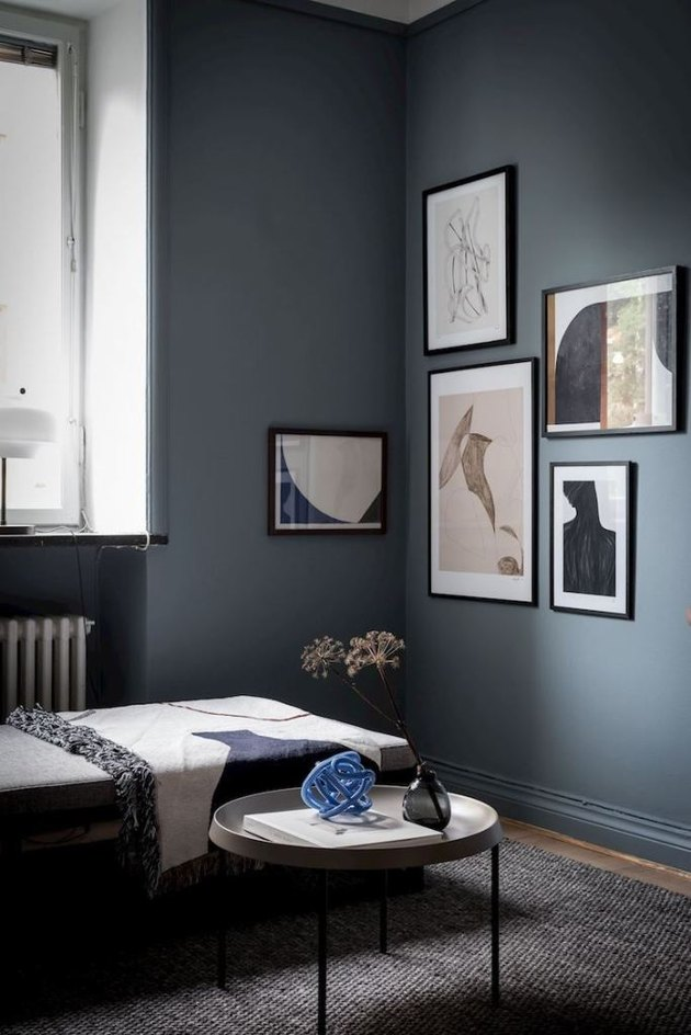 Blue bedroom color idea with gallery wall artwork and daybed by window