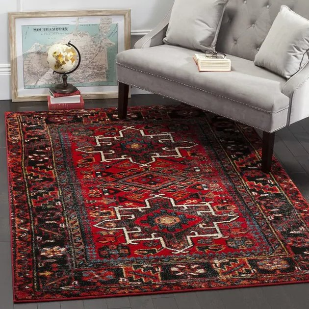Persian rug with red and black as dominant colors