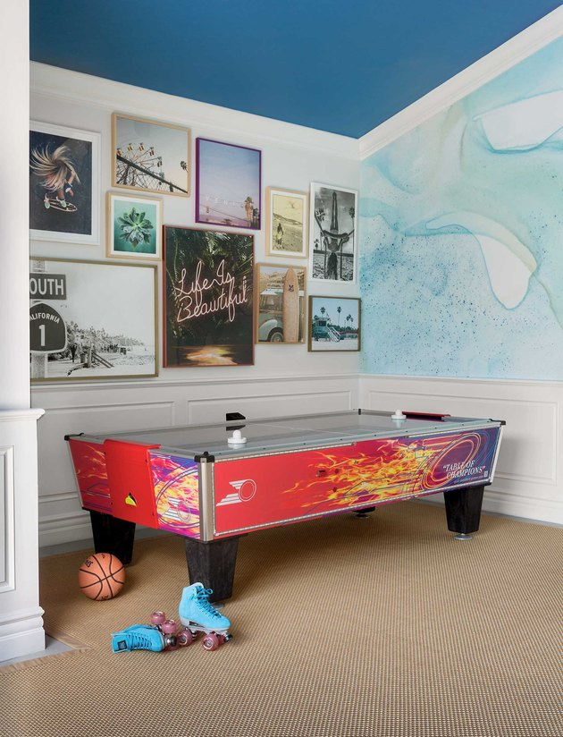 garage game room ideas with air hockey and gallery wall