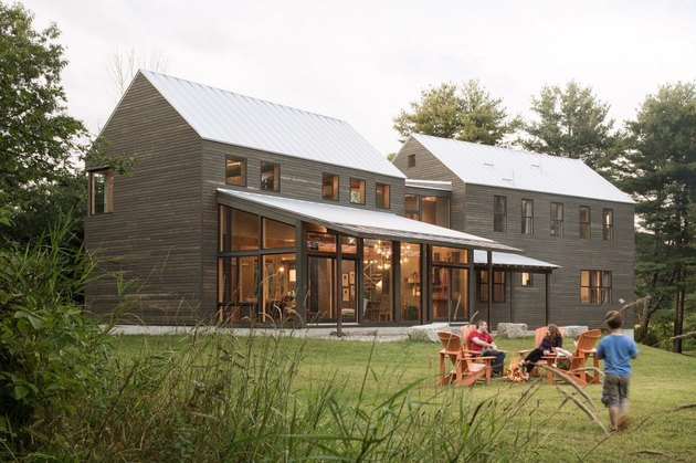 Modern farmhouse with a timber roof and expansive windows