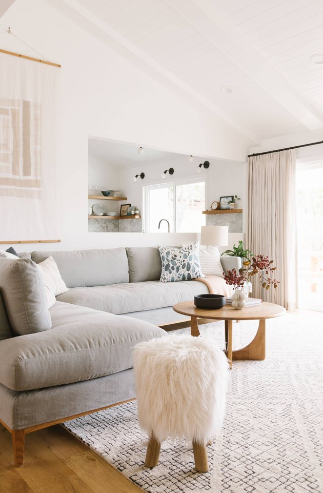 white living room with layers of light wood
