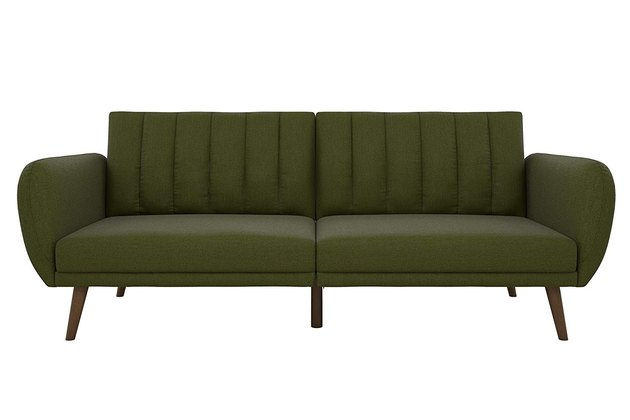 green sofa with wooden legs
