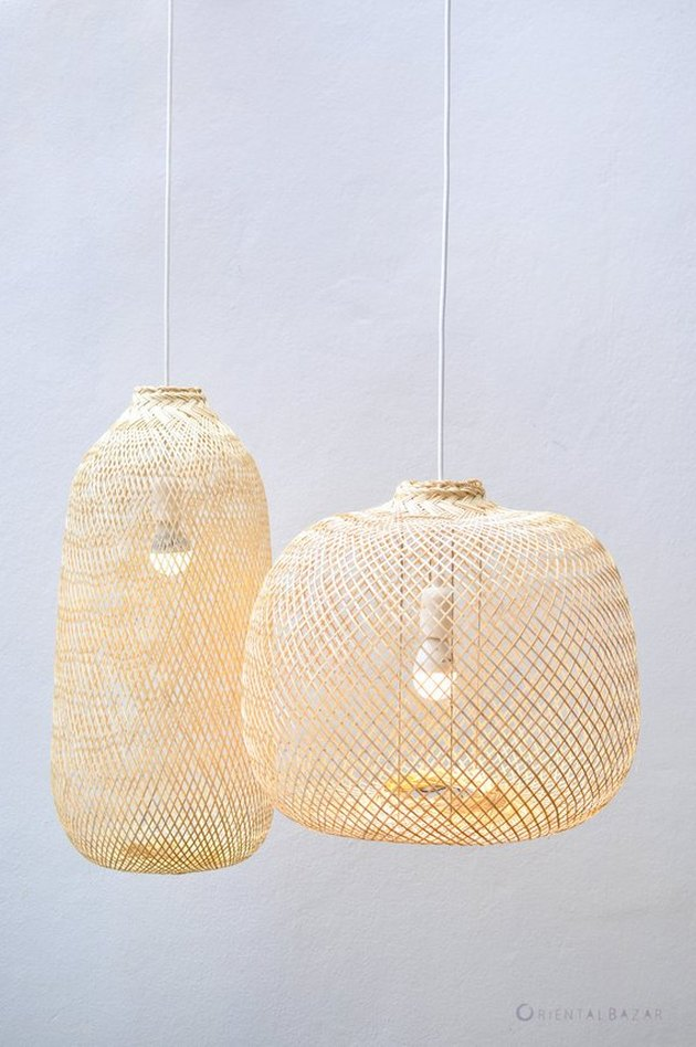 Two woven pendant lights; one in an oval shape and one circular