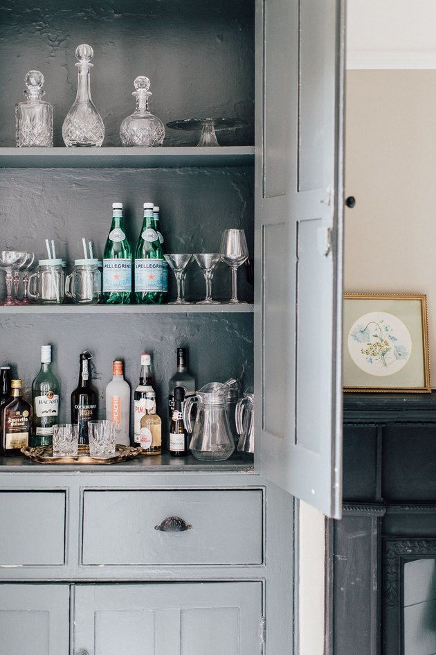 blue cabinet in dining room