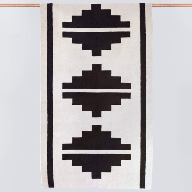 Accent rug with black-and-white Aztec design