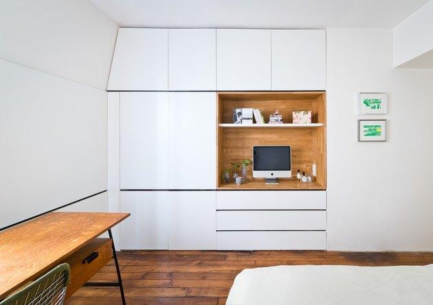 minimalist bedroom with built in storage