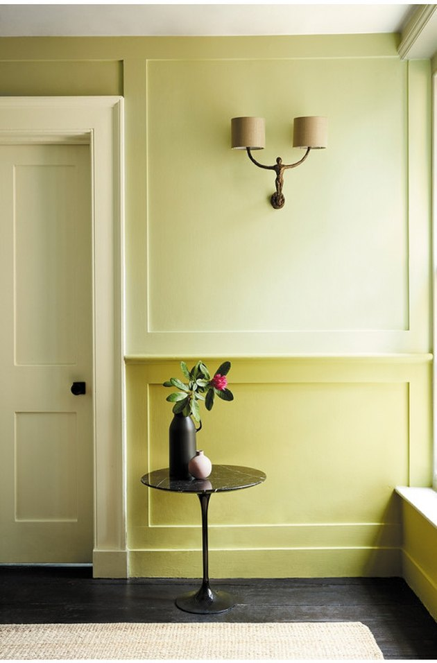 Two-toned green painted hallway
