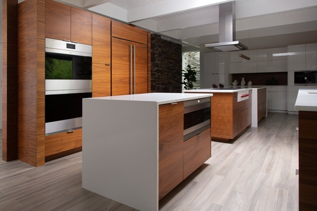 open kitchen with dark wood cabinetry and white countertops