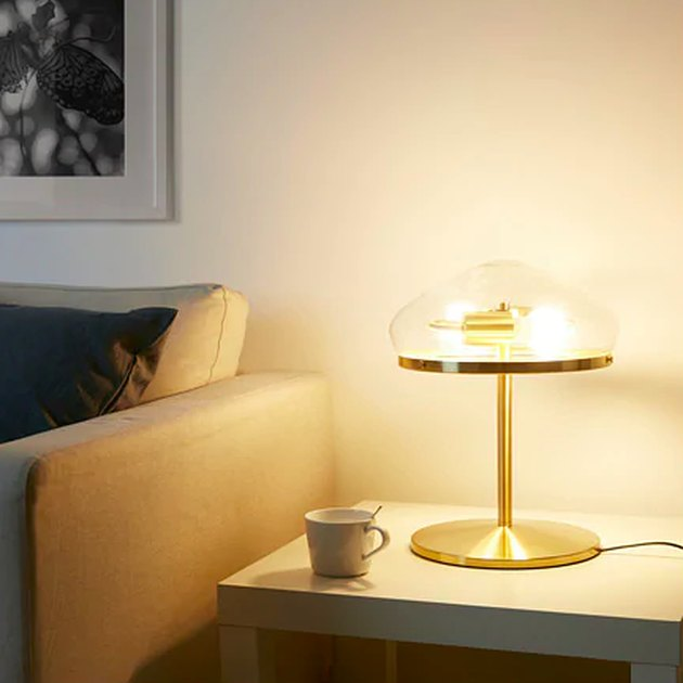 gold lamp near a couch