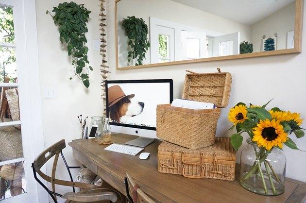 vintage woven basket storage in bedroom office