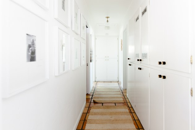 Neutral hallway with gallery wall and runners