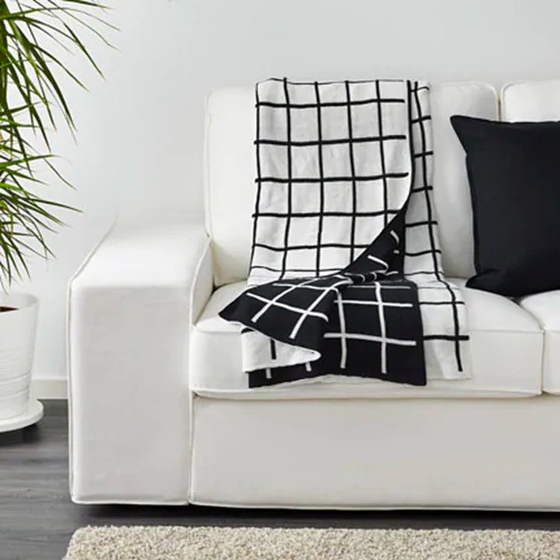 black and white throw blanket on white sofa