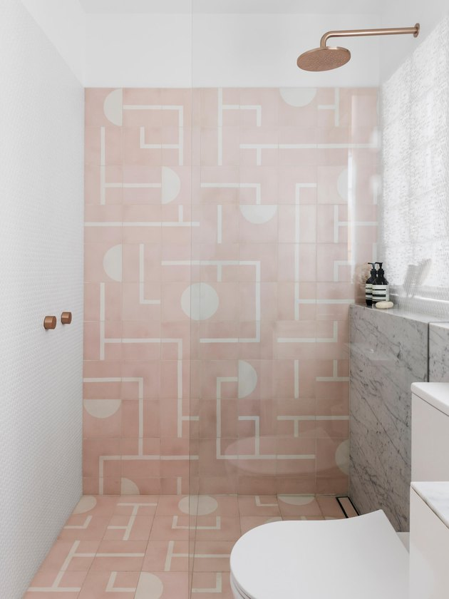 A bathroom with a pink shower