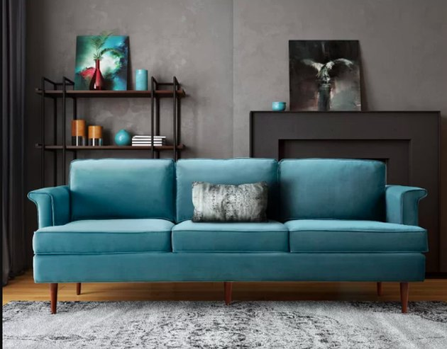 blue couch in living room near shelf
