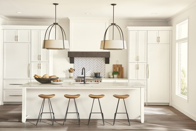 kitchen with white walls and stools