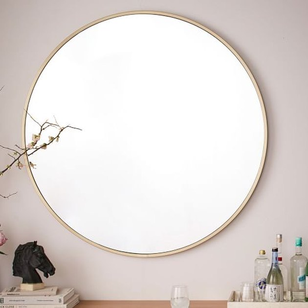 Round wall mirror with brass frame