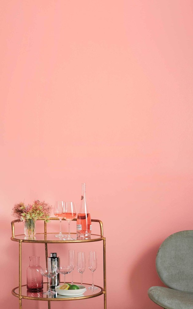pink coral wall with bar cart