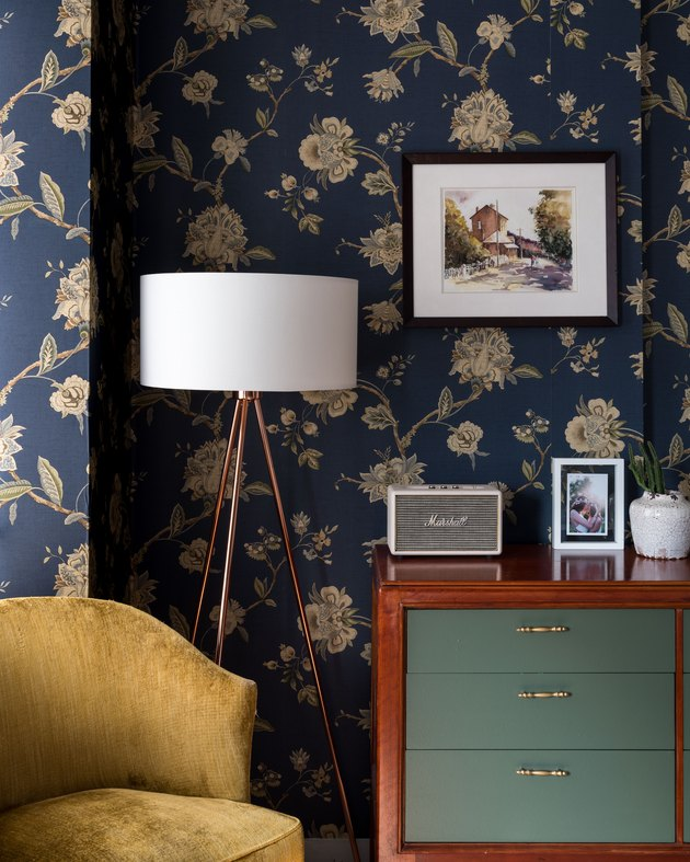 bedroom with navy floral wallpaper