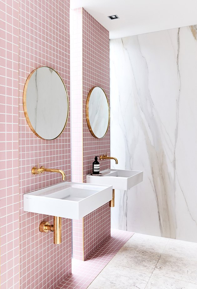 bathroom with pink tile and marble slab walls