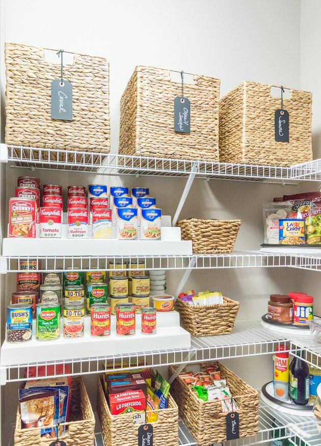 organized small pantry closet  with woven bins