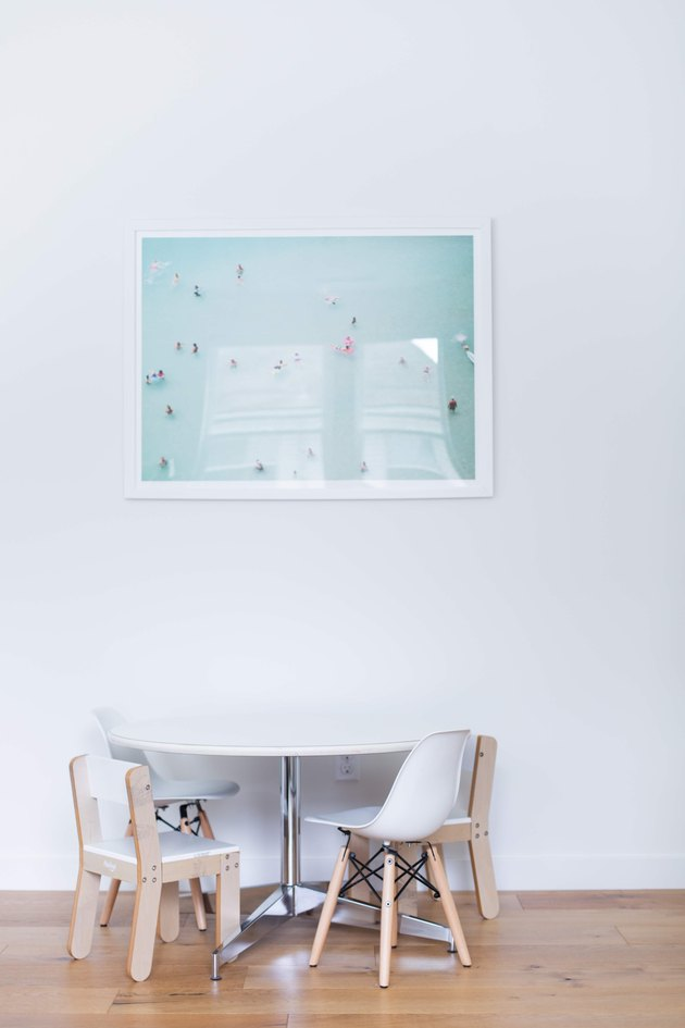 Modern artwork, table, and chairs in Meakins home