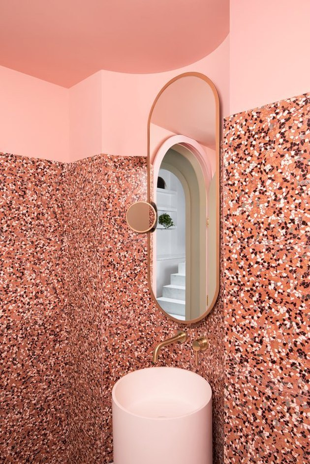 pink bathroom with terrazzo walls