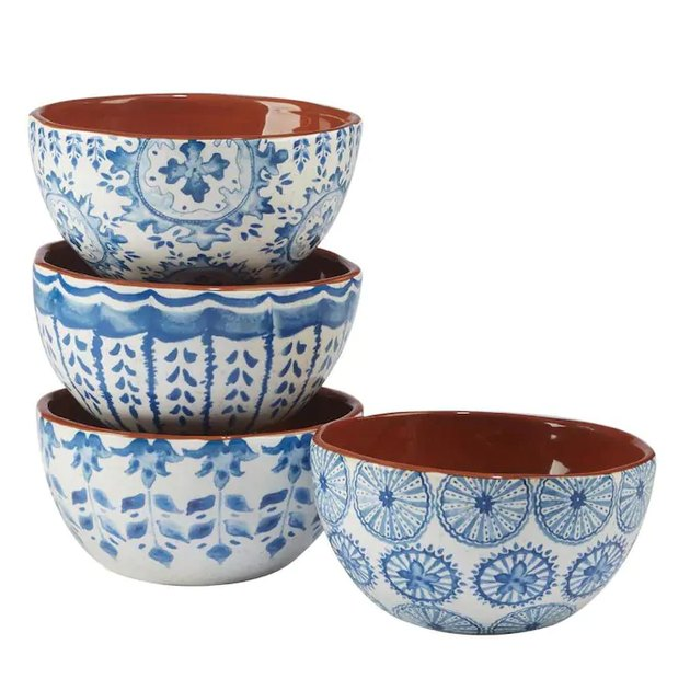 four blue and white bowls