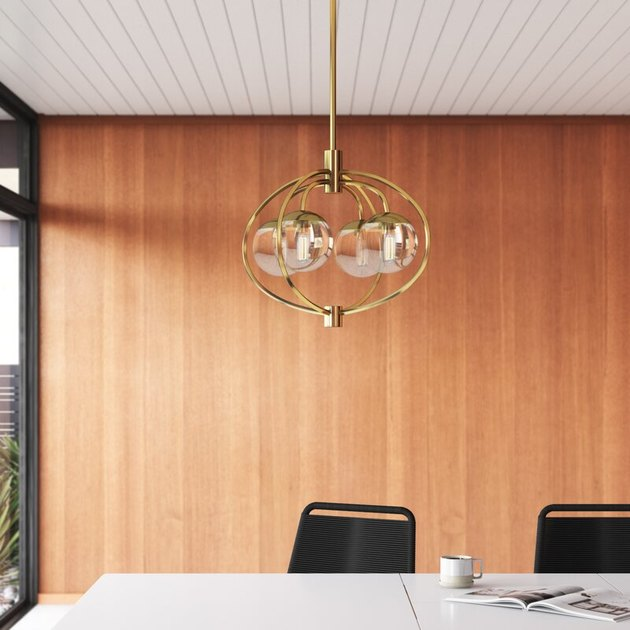 Gold and glass contemporary dining room lighting above table