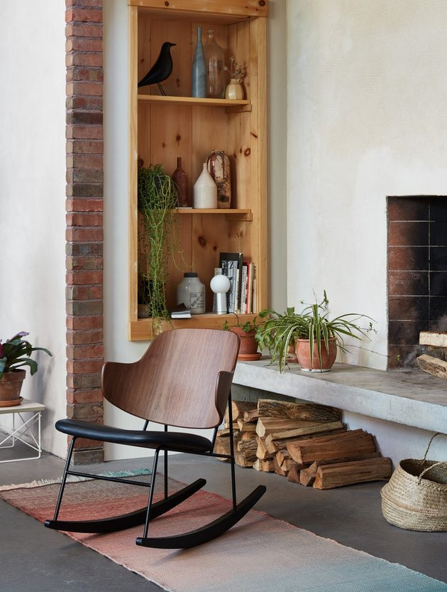Design Within Reach contemporary rocking chair near fireplace