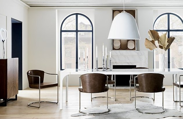 White aluminum contemporary dining room lighting above table