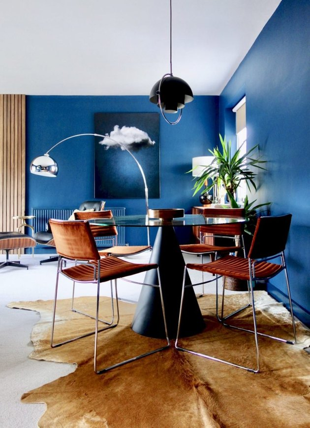 Contemporary apartment with blue walls and dining area