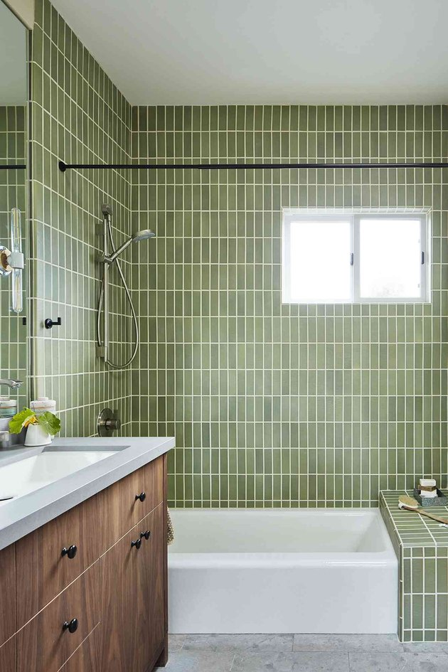 contemporary shower with green vertically set tiles