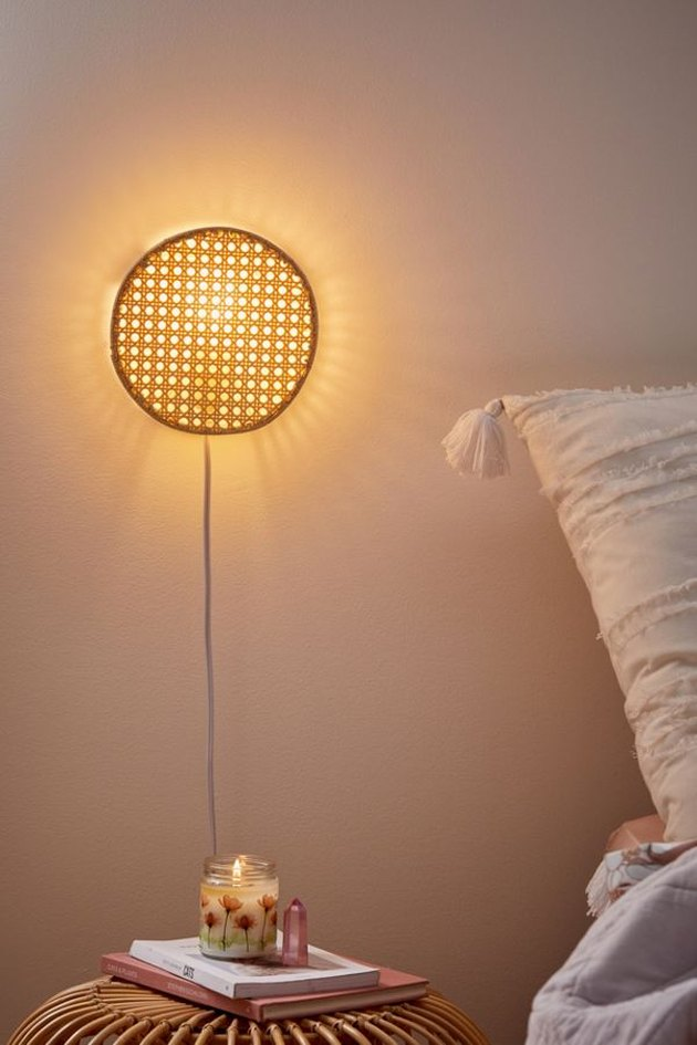 Lexi Rattan bedroom wall sconce from Urban Outfitters